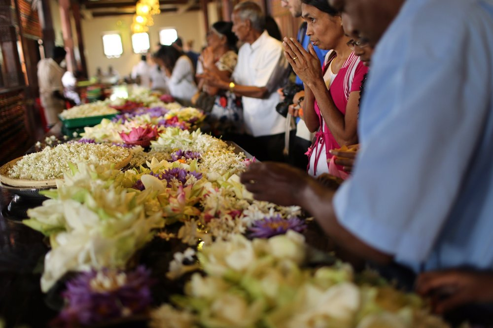 Prayers and flowers are left at the Temple of the Tooth in Kandy, Sri Lanka.