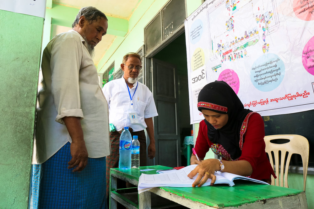 A woman takes notes on voting records in Yangon.