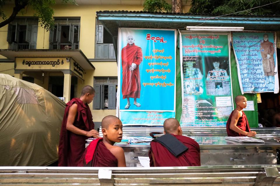 Young radical monks sit under a Wirathu poster at the Masoyein Monastery. Mandalay.