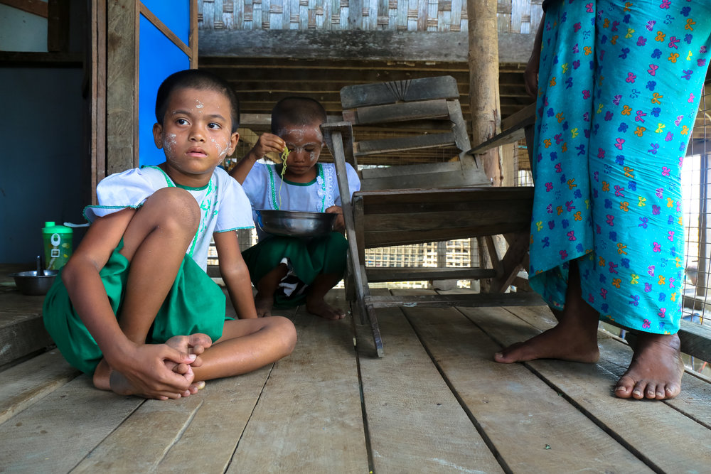 Buddhist Rakhine IDPs sit on the floor of their home in an IDP camp in Sittwe, Rakhine State. June 2017.