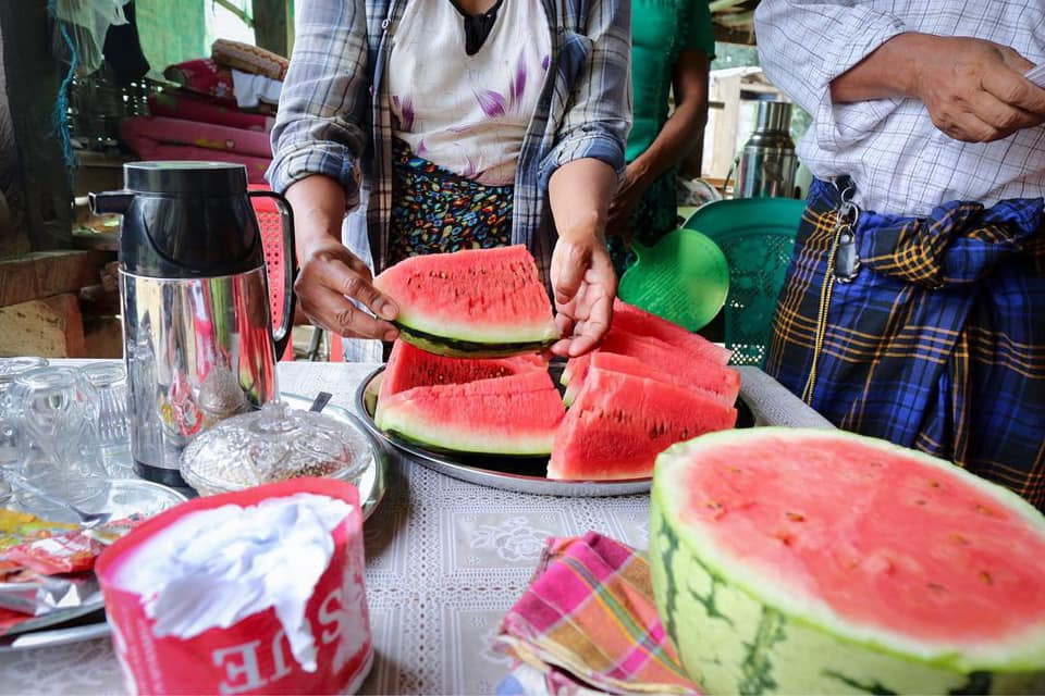 Being fed watermelon while along the Irrawaddy River.