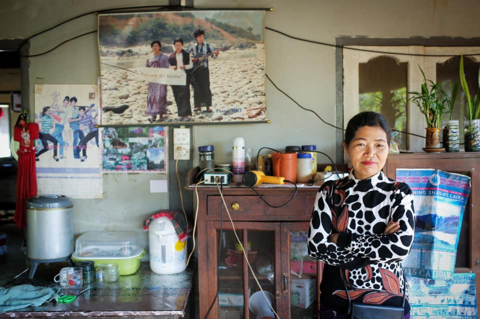 A Kachin woman who organizes her community to protest against corrupt Chinese dam companies and makes/sells her own Kachin alcohol.