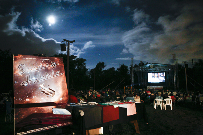 The Hubble Roadshow, presented under the stars in an outdoor amphitheater in Connecticut, featuring experimental music, reflections from an engineer who built Hubble, and stargazing following the movie.