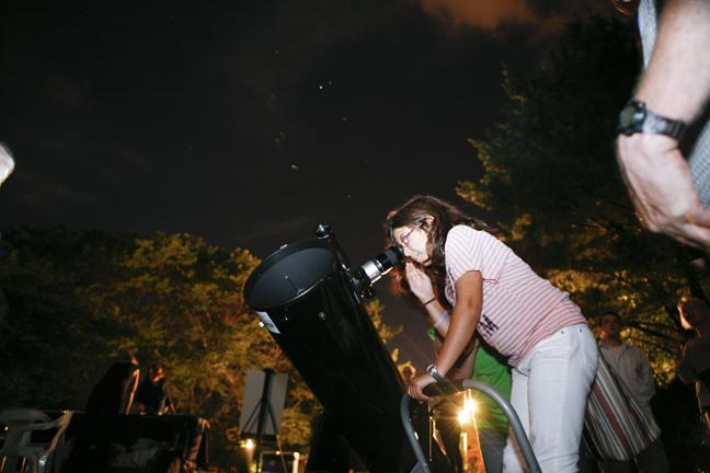 Stargazing on a warm, clear summer night.