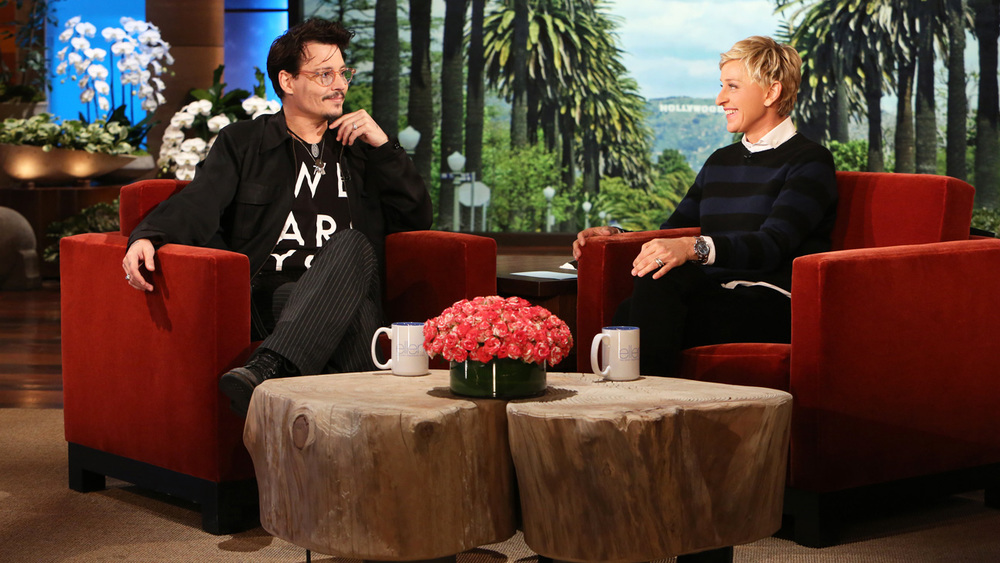Johnny Depp wearing the We Are You T-Shirt on the Ellen Degeneres Show, April 2014. Image via  The Ellen Degeneres Show