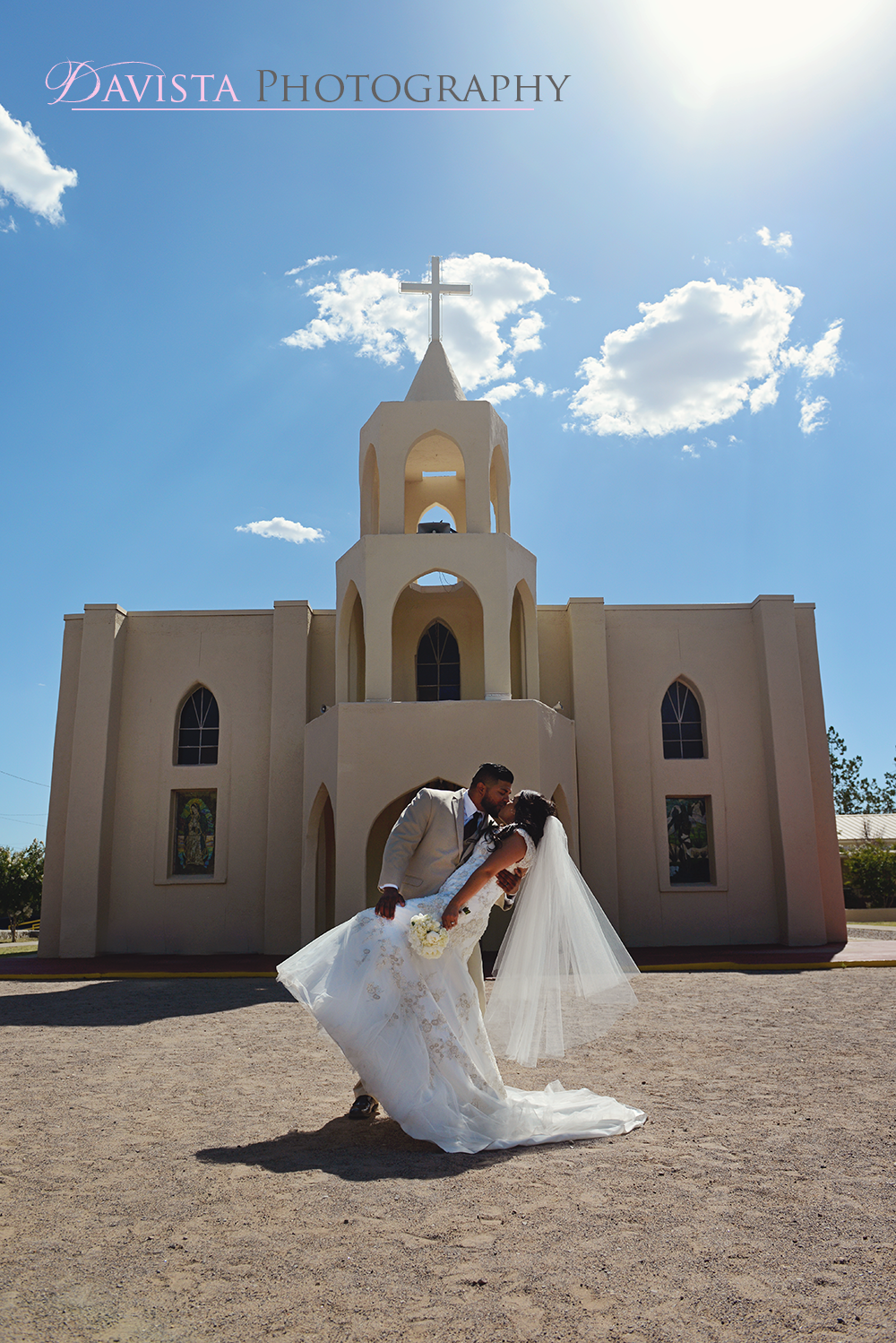 outdoor-new-mexico-wedding-poses-in-front-of-church
