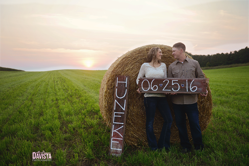 save the date couples in a field photography