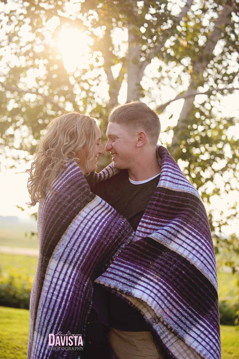 couples poses wrapped up together in blanket