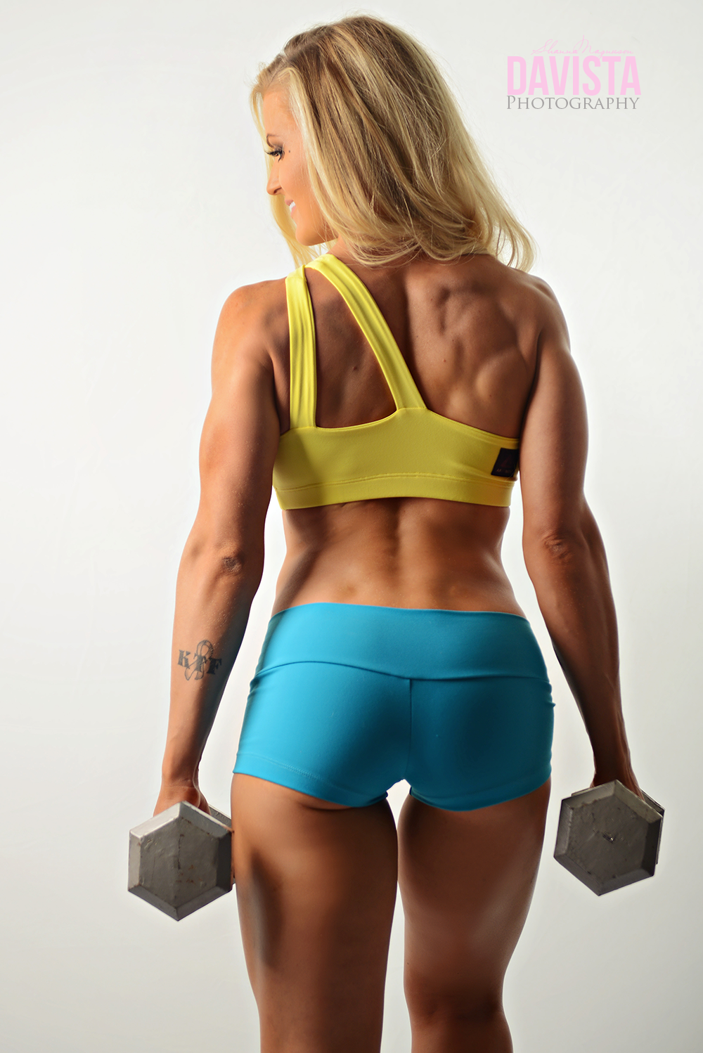 unique fitness photographer with weights