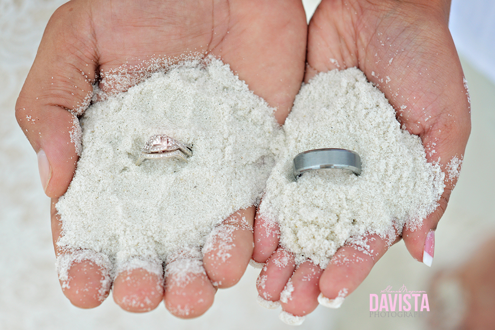 gorgeous wedding rings and band in the sand details