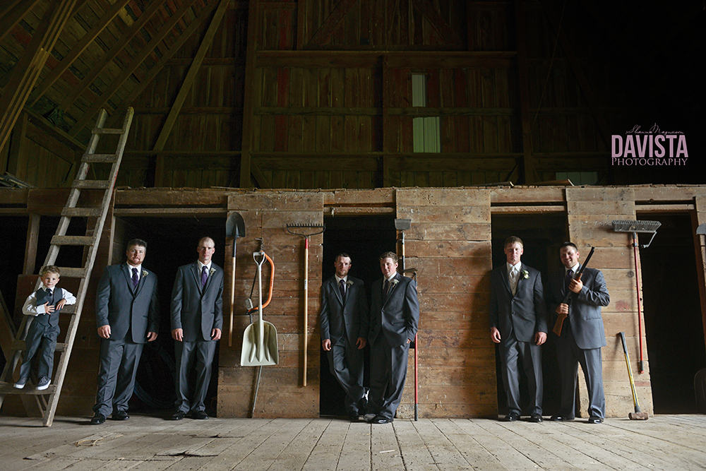 handsome groom and groomsmen barn wedding