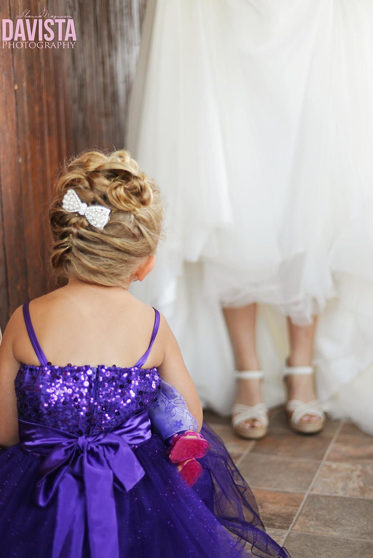 flower girl looking at bride