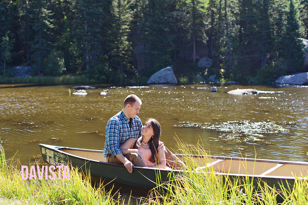couple in canoe in water photos