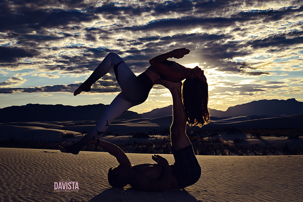 silhouette of acroyoga couple pose