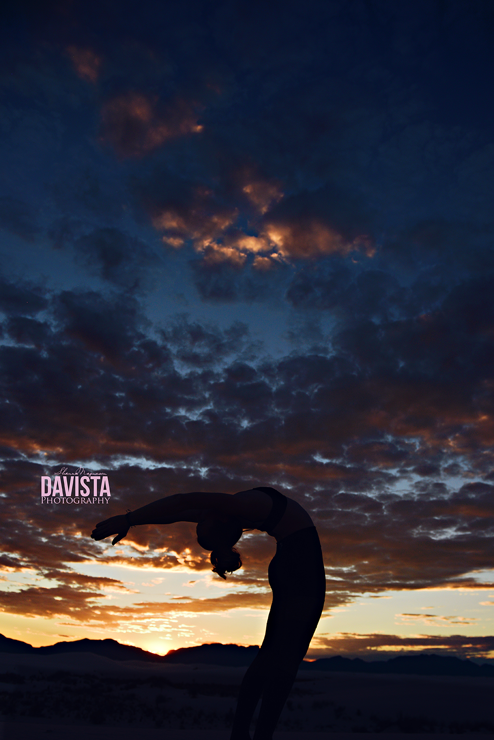 silhouette backbend in sunset