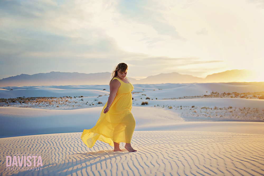 gorgeous woman in yellow dress on white sands