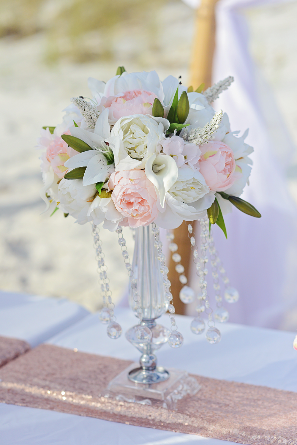 wedding floral details on the beach