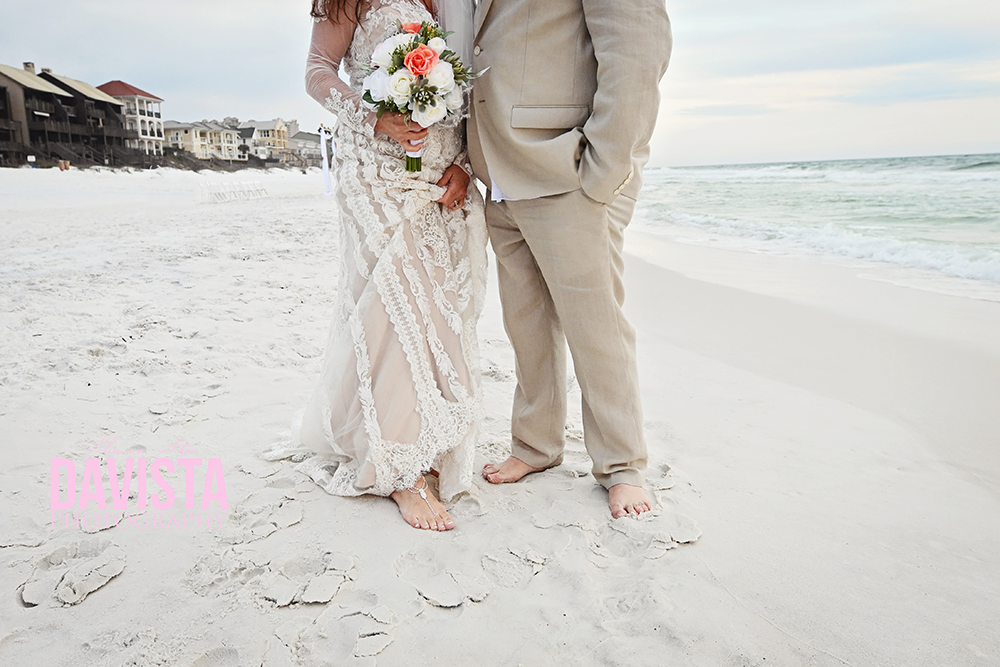 bride and groom toes in the sand