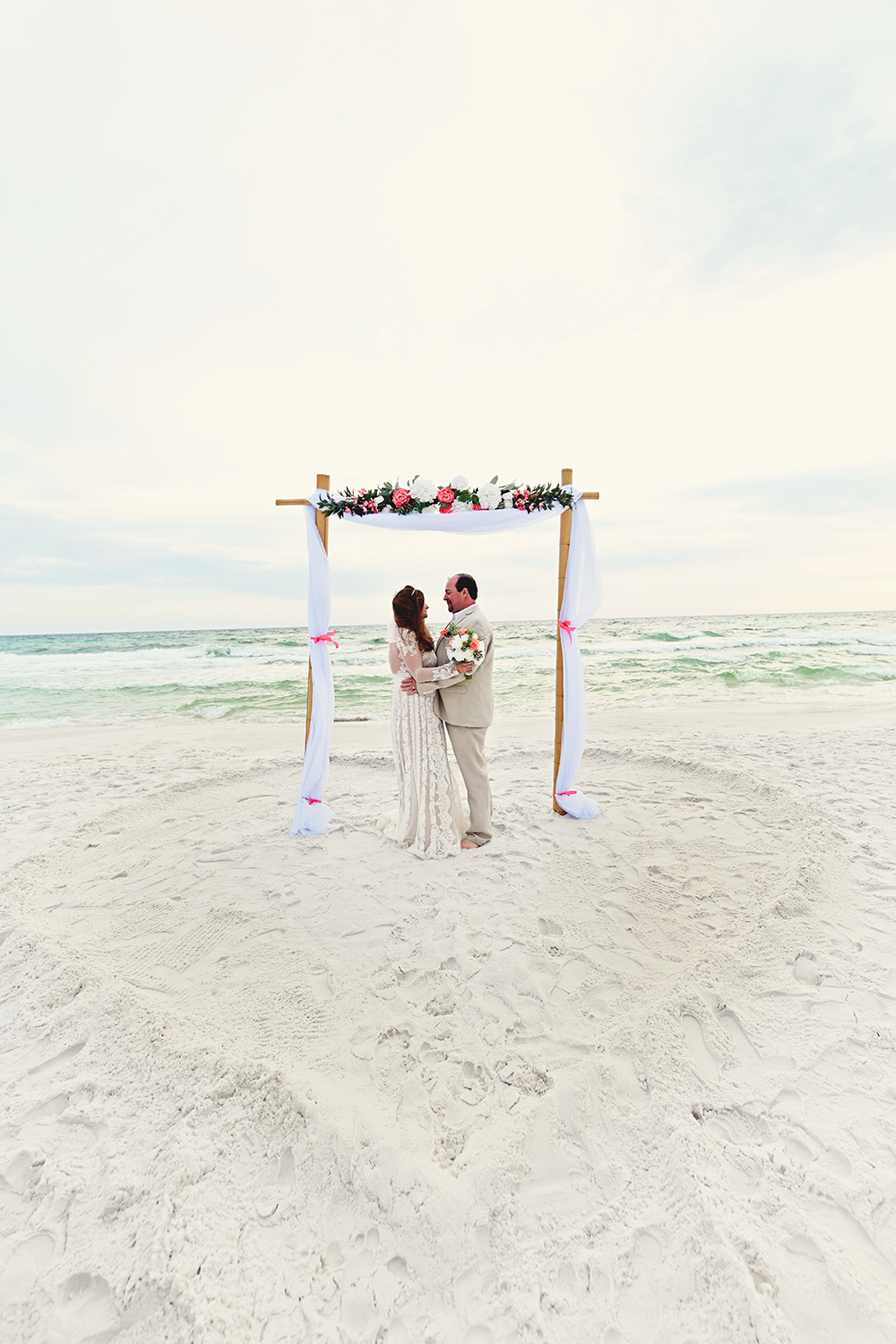 heart in the sand wedding photos