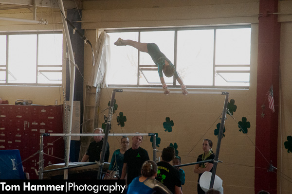 """Zoe cranking out """"giants"""" on the uneven bars, her favorite event."""