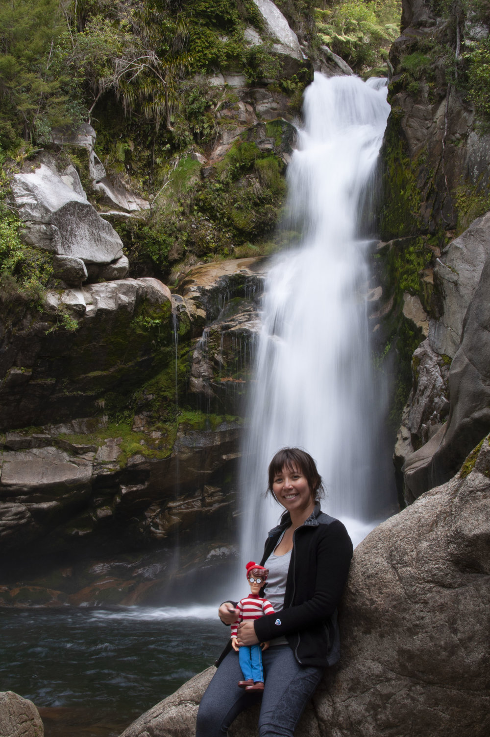 Yep, that's right. I hiked with a doll to take a photo in front of a waterfall! It's not weird or anything.  Photo Credit - ©robbiemyers