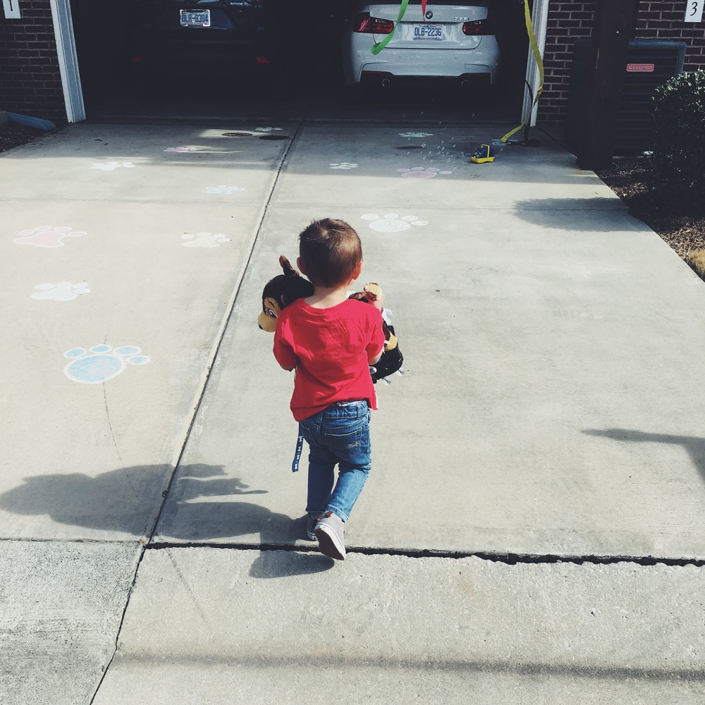 Chalk puppy paws leading into the garage when Grandma and Grandpa Linn brought him home from Build- A- Bear. (Can you guess what stuffed animal he got?) Hint: Paw Patrol.