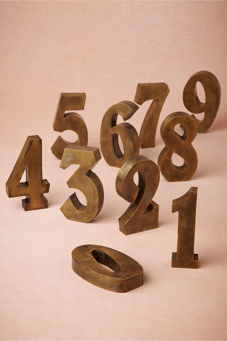 These Antiqued Brass Table Numbers are my favorite! They would warm up reception tables beautifully.
