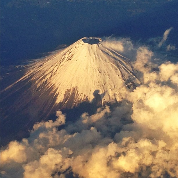 jay7one7: #mtfuji from above. #mountain #japan #clouds #snow #airplane #volcano