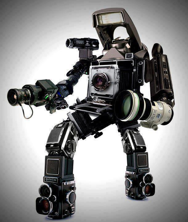 dprblog: Check out this amazing digital and analog camera robot! (via Fro Knows Foto)