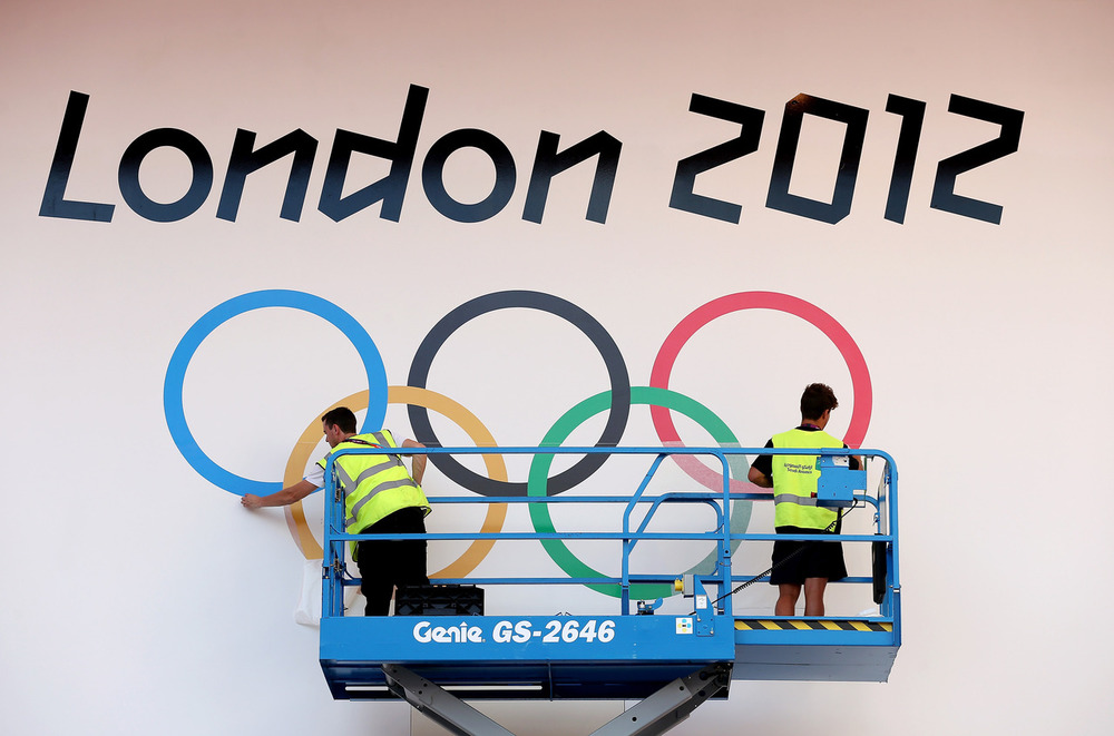 olympics: The Finishing Touches! Workers prepare a London 2012 banner at ExCel on July 24, 2012 in London, Great Britain. Photo by Scott Heavey/Getty Images