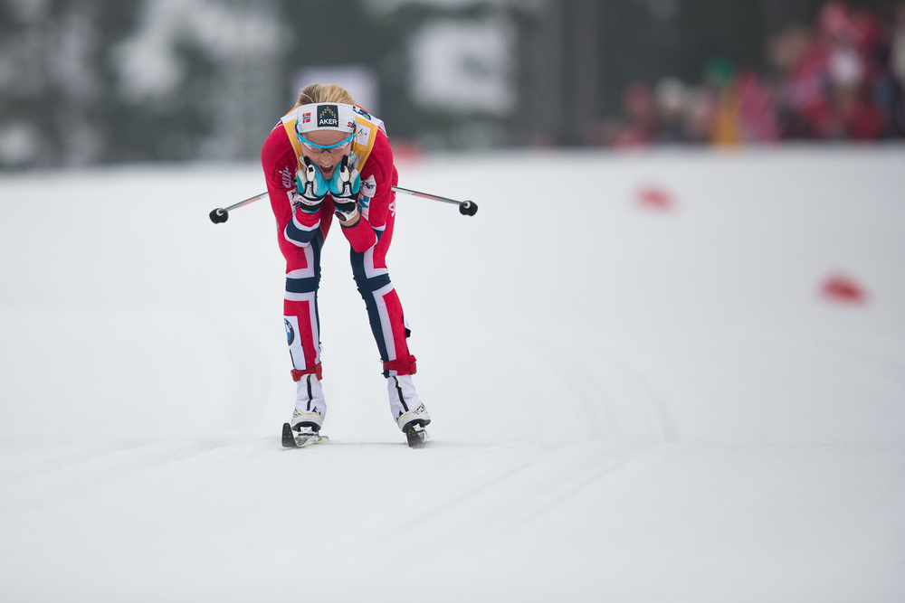 Therese Johaug follows Bjørgen by roughly 60 seconds.