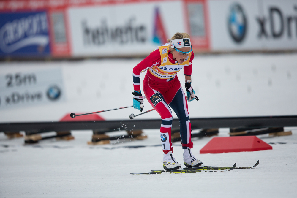 Therese Johaug making on her penultimate trip round the stadium.
