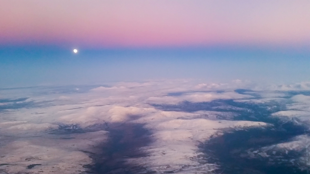 Our lunar friend, rising in the east as I flew from Trondheim to Oslo