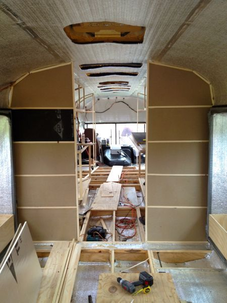 Insulation in the rear bathroom walls...looking from the back of the bus forward...