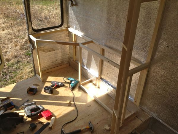 Framing in the cabinetry for the bedroom/studio area...
