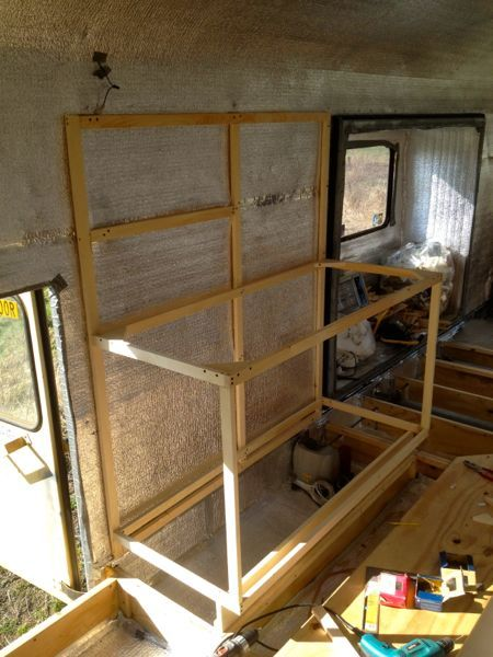 The start of kitchen cupboard and counter framing...