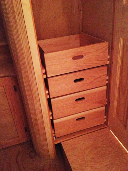 Dresser drawers in place. The face board is made from the same cedar as the cabinet door frames.