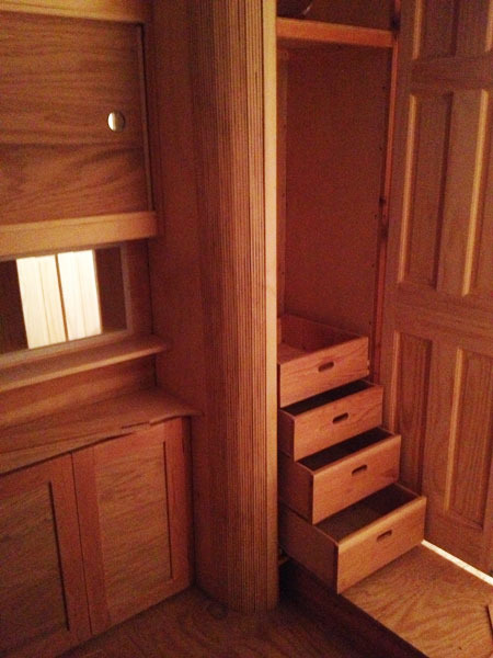 Dresser drawers double as stairs so little people can go to Narnia too.