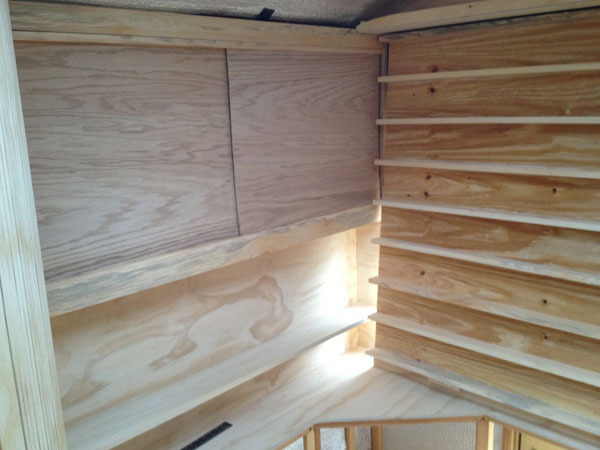 Cabintry work in the studio and bedroom area began with a couple sliding oak doors and a shelf made from a poplar board.