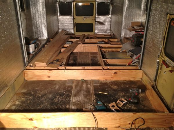 Everything from the back room forward is going to be raised about 9 inches above the original floor to make space for storage, plumbing and any electrical wiring. The picture shows supports for the back bedroom/studio space and the start of the bathroom area.