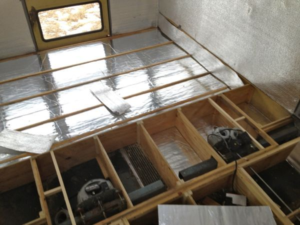 """After the floor supports were all in place I started cutting 1"""" foam board insulation to fit in between...."""