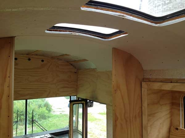 The last of the ceiling panels being installed in the very front of the bus.