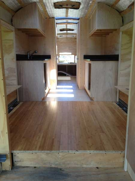 The flooring that I put together in Winter finally got to move onto the bus. There are a total of 6 removable flooring panels...4 sections of bamboo and 2 sections of tile.   They're all fairly manageable size and weight so it won't be too hard to remove them to access anything in the under-floor storage areas if need be.
