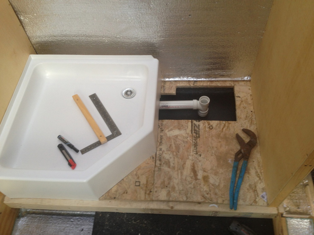 Drain pipes for the shower running from under the floor pan into the gray water tank.