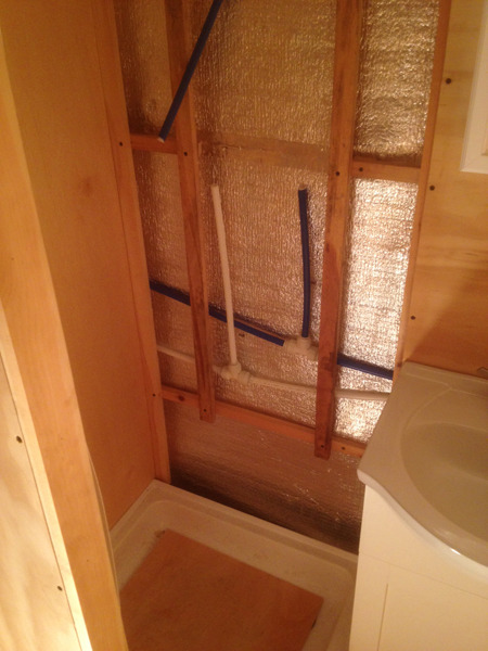 Hot and cold water lines being installed for shower hookups.