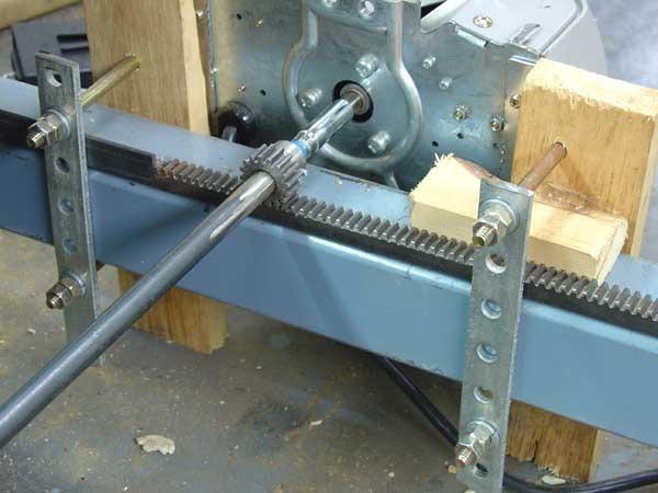 Garage door motor rack and pinion close up