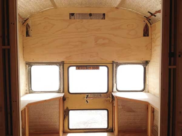 Back and side walls in place in the back of the bus with top surfaces added to the cabinets.
