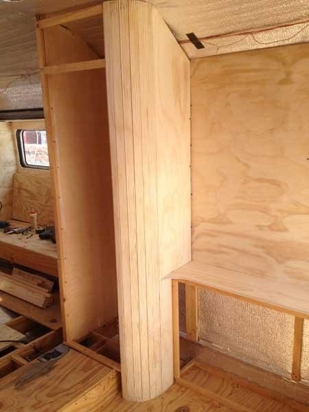 studio-bedroom-passenger-side-closet-without-door.jpg
