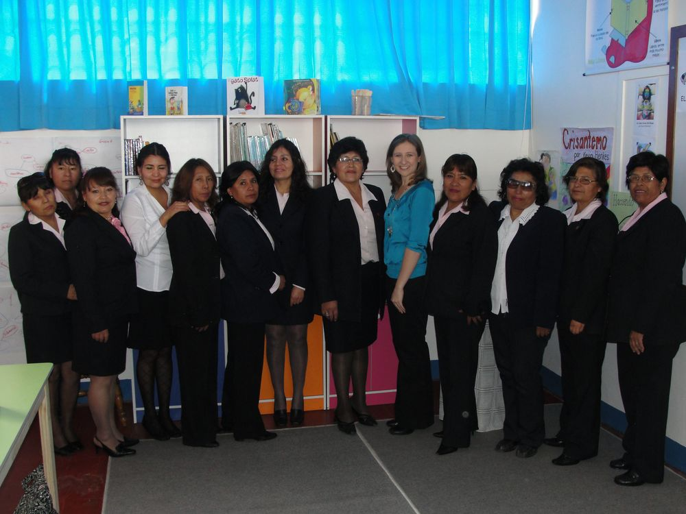Lucia (CUDA Living Library director) and me posing with most of the teachers from the school from this school year