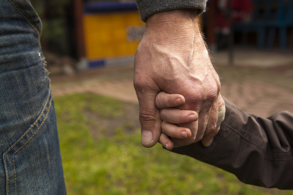 iStock-482970721 - holding hands - clean download.jpg